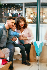 Happy Family Shopping And Having Fun In Mall