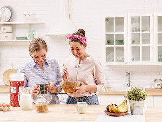 Two cheerful friends cook together. Friends Chef Cook Cooking Concept