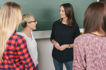 Group of women standing having a discussion