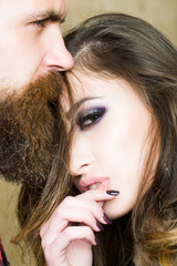 Fashion beautiful couple. Hipster boy and girl. Bearded man and beauty