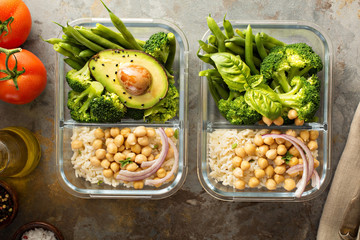 Vegan meal prep containers with cooked rice and chickpeas