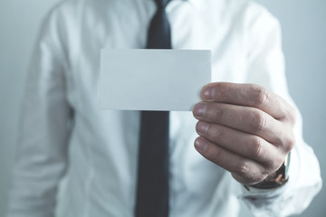 Businessman showing empty business card.