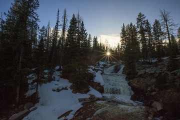 Sunbeams above a waterall, Uinta mountains, USA.