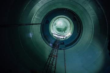 Inside unfinished reactor vessel of abandoned nuclear power plant. Bottom view of metal dome Wall mural