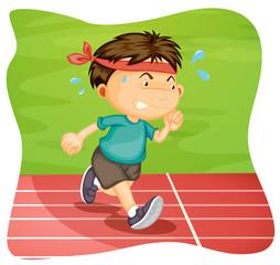 A Boy Running on Running Track