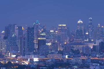 Modern city skyline at night.