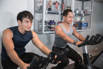 Asian male doing cardio excercises