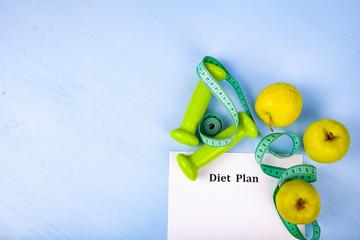 Apples, diet plan,dumbbells and measuring tape