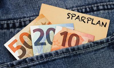 Sparplan Banknoten mit Visitenkarte in einer Hosentasche