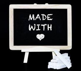 Made with love symbol on blackboard