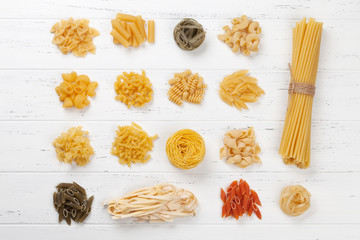 Various pasta on white wooden table