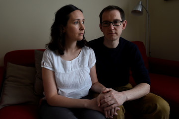Amy Callahan, who received a fatal foetal diagnosis at 12 weeks into her pregnancy and travelled to Liverpool for a termination, poses for a photograph with her partner Connor Upton, at their home in Dublin