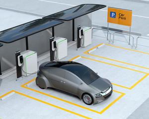 Metallic gray autonomous car recharging in parking lot. Electric car charging service concept. 3D rendering image.