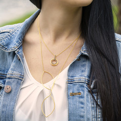 Woman wearing beautiful golden necklaces
