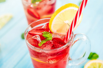 Strawberry lemonade juice with ice cubes in the glasses