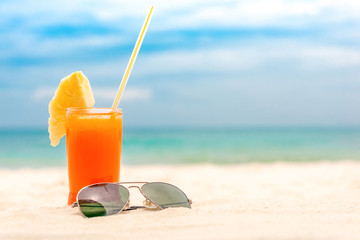 Refreshing tropical fruit juice drink at summer beach