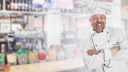 Portrait of a cheerful male chef cook