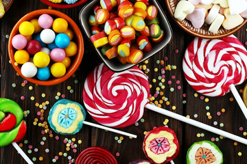 Photo sur Aluminium Confiserie candies with jelly and sugar. colorful array of different childs sweets and treats.