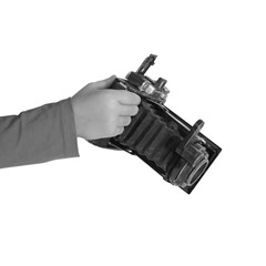 Photocamera in hands by close-up on the white isolated background.