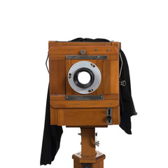 The retro camera on the white isolated background.