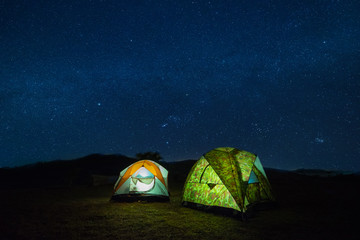 camping in moutain at night with star.