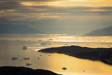 Icebergs in the fjord, surrounded by mountains, dusk, West Greenland, Greenland, North America