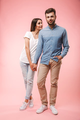 Full length portrait of a smiling young couple