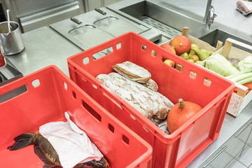 Delivery boxes with fresh food ready for inspection in kitchen of restaurant