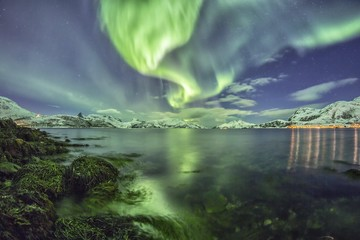 Northern lights at a fjord in Tromso, Norway, Europe