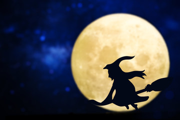 Witch silhouette over a full moon