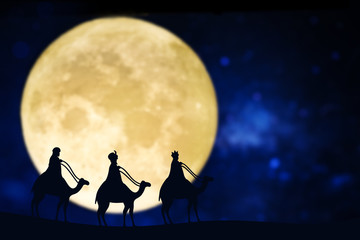 Three wise men silhouette over a full moon