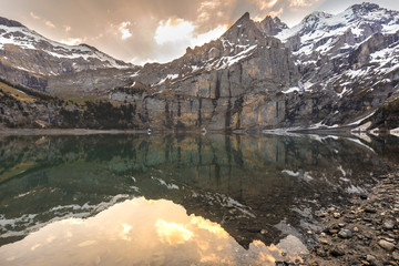 Oeschinen lake in Switzerland Kandersteg in the morning with a reflection of the mountain in the lake