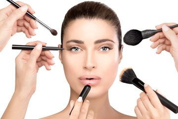 Beauty and cosmetics concept. Beautiful face. Makeup process