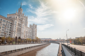 Beautiful city summer landscape, the capital of Russia Moscow, the embankment of the river in the city center, view of the skyscraper on Kotelnicheskaya