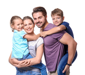 Portrait of couple with children on white background. Happy family