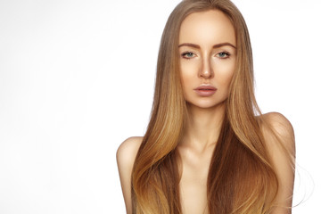 Beautiful yong woman with long straight shiny hair. Sexy fashion model with smooth gloss hairstyle. Keratin treatment