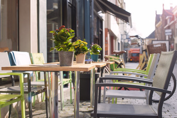 Tables with flowers in a cafe on the street. Travel in Europe. Netherlands