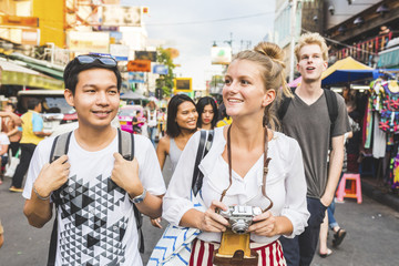 Thailand, Bangkok, Khao San Road, portrait of friends exploring the city