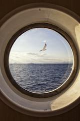 Sea view through porthole