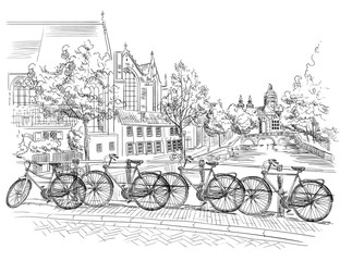 Bicycles on bridge over the canals of Amsterdam, Netherlands