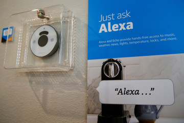 Prompts on how to use Amazon's Alexa personal assistant are seen in an Amazon 'experience center' in Vallejo