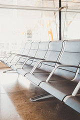 Waiting chairs for passenger before boarding at the gate of airport