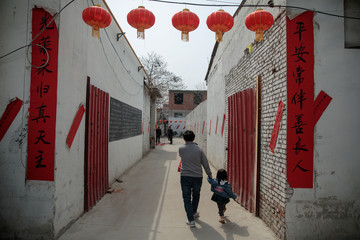"Banners with religious slogans are placed outside an ""underground"" Catholic church run by outspoken priest Dong Guanhua, as it is decorated for the Easter celebration in Youtong village, Hebei province"