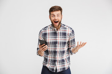 Portrait of a happy young man in plaid shirt