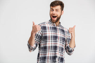 Portrait of an excited young man in plaid shirt