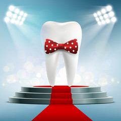 Human white tooth with red bow tie