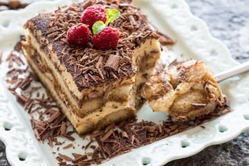 Dessert Tiramisu Cake with Grated Chocolate, Raspberry and Mint
