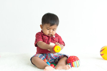 Cute asian little boy play wooden toys