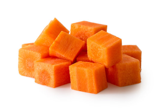 Pile of diced carrot isolated on white.