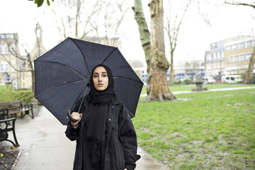 Portrait of a female Muslim student in a city street